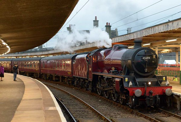45699 Galatea, 1Z87, Carnforth, Sat 3 March 2017 - 1745.  The Jubilee arrives with the Railway Touring Co's Winter Cumbrian Coast Express.  86259 Les Ross worked it from Euston to Carnforth and back, with Galatea handling the rest without diesel assistance.  The gauging problems which had prevented 45699 working north of Ravenglass in 2016 have evidently been overcome, at least in the up direction.  The 11 coaches were 80217, 99723, 4973, 4984, 1861, 99125, 99371, 3136, 1961, 99122 & 3058.