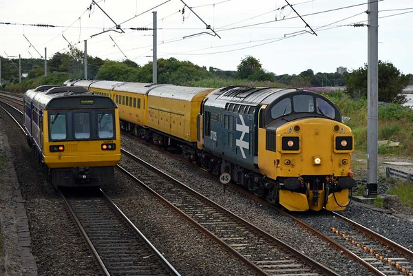 142016 (2H05) & 37025 Inverness TMD T+T 37219 Jonty Jarvis (1Q83), Hest Bank, Fri 14 July 2017 - 1838.  Northern's 1645 Leeds - Morecambe meets Colas Rail's 1350 Blackpool North - Blackburn - Derby returning from Morecambe.  The 1Q83 consist was brake force runner 96608, overhead line inspection coach 977983, plain line pattern recognition coach 5981 & generator van 6260.