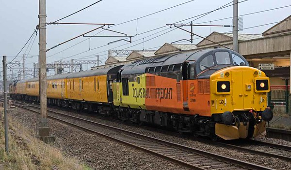 37099 Merl Evans 1947 - 2016 & 37175, 1Q47, Carnforth, Tues 14 February 2017 - 1653.  Whoops! Colas Rail's 1052 Derby - Carlisle High Wapping test train, scheduled to run via the Cumbrian coast, sets back to the goods loop after being mis-routed towards Shap.  It set off for the coast at 1709. The consist was 6264, 999550, 1256 & 999606.