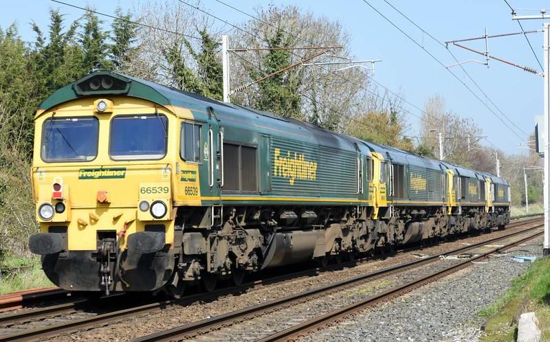 66597 Viridor, 66596, 66957 Stephenson Locomotive Society 1909 - 2009 & 66539, 0Y60, Carnforth, Sat 8 April 2017 - 1330.  Freightliner's 1159 Basford Hall - Carlisle yard move.  66539 subsequently worked 6Y60 1613 Carlisle yard - Garstang.  66597 T+T 66596 worked 6Y61 1652 Carlisle yard - Garstang.  Both trains then terminated at Basford Hall.