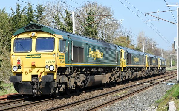 66597 Viridor, 66596, 66957 Stephenson Locomotive Society 1909 - 2009 & 66539, 0Y60, Carnforth, Sat 8 April 2017 - 1330.  Freightliner's 1159 Basford Hall - Carlisle yard move.  66539 subsequently worked 6Y60 1613 Carlisle yard - Garstang.  66597 T+T 66596 worked 6Y61 1652 Carlisle yard - Garstang.  Both trains then terminated at Basford Hall.