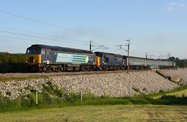 57311 Thunderbird, 37422 & 57007, 5Zxx, Carnforth, Fri 26 May 2017 - 1951 1.  DRS's 1810 Barrow carriage sidings - Kingmoor move.   37422 had failed at Carnforth the previous day on Northern's 2C32 0515 Carlisle - Preston because of a faulty relay.  The train returned empty to Barrow as 5C47.  DRS sent 37424 & 66430 from Kingmoor to recover it but 37424 failed on the up main alongside Eden Valley loop and had to be towed back to Kingmoor by the 66.  Until the locos were removed, up trains had to run through the loop to pass them.  DRS sent 57007 from Kingmoor to Barrow via Carnforth on the 26th to bring the train from Barrow.  57311 was then sent separately from Kingmoor to Carnforth.  The coaches were 5995, 6064, 6117 & DBSO 9709.