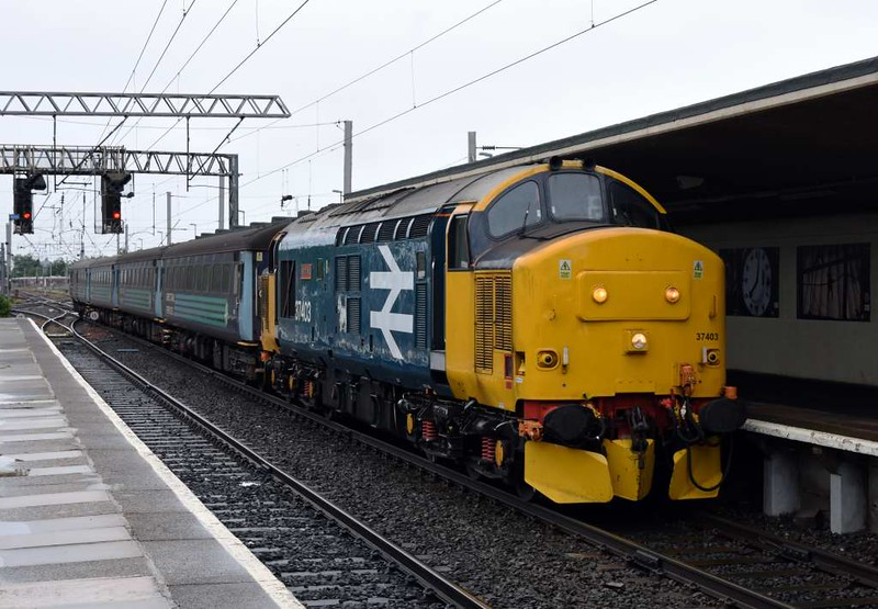 37403 Isle of Mull, 2C47, Carnforth, Thurs 8 June 2017 - 1050.  Northern's slightly late 1004 Preston - Barrow.  It was formed of 5995, 6064, 6117 & DBSO 9709.