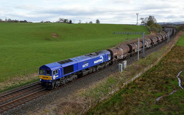 66727 Maritime One, 6S94, Penrith, Wed 5 April 2017 - 1729.  The 66 heads GBRf's WO 0203 Dollands Moor - Irvine clay about five hours late after 92032 failed at Grayrigg.