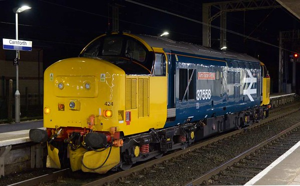 37424 Avro Vulcan XH558, 0Z23, Carnforth, Wed 8 March 2017 - 2139.  DRS's 2000 Barrow - Kingmoor move.  After completing its diagram on the 7th at Barrow, 37424 had failed the following morning and had to be replaced by 156490.  37402 had earlier run light from Kingmoor to Barrow via Carnforth (0Z22 1630 from Kingmoor) to replace it on the 9th.