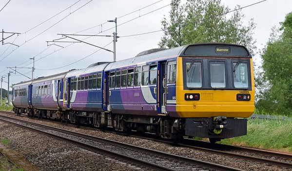 142025 & 156487, 2C47, Carnforth, Tues 13 June 2017 - 1034.  Northern's 1004 Preston - Barrow, formed of DMUs after 37424 / 9709 had failed the previous day at Barrow.  66432 took them to Kingmoor via Carnforth on the 13th.