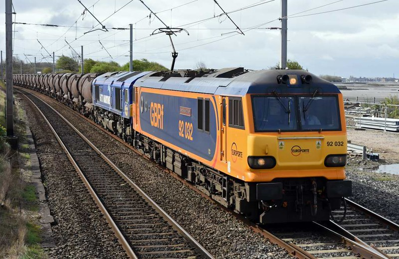 92032 IMechE Railway Division & 66727 Maritime One, 6S94, Hest Bank, Wed 5 April 2017 - 1139.  GBRf's WO 0203 Dollands Moor - Irvine clay.  92032 failed later at Grayrigg. This train starts at Antwerp, and is hauled to Calasi Frethun by a Belgian loco.  It is then hauled through the Channel Tunnel to Dollands Moor by two class 92s because of the steep gradients.  One of the 92s is then detached and replaced by a 66 which hauls the train to Wembley as GBRf 92s no longer work on third rail.  Then the 92 and 66 swap places so the 92 leads to Carlisle yard, where the 92 is detached and the 66 works forward to Irvine via Dumfries.