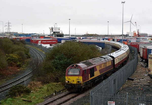 67022 & 67008, 1Z19, Heysham, Sat 18 March 2017 - 1502.  Setting off for Euston via Preston.  The 10 coaches were reported as 21269, 3123, 3066, 1651, 3068, 3120, 3147, 1832, 4927 & 4959.  The power station branch is at left, with Seatruck's Clipper Pennant beyond on the Warrenpoint run.  Just visible in the distance above the loco UK Dredging's suction hopper dredger Orca is at work.