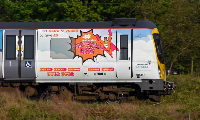 185146, 1C76, Carnforth, Tues 2 May 2017 - 1814.  Northern's 1720 Barrow - Windermere.  The TPE DMU has been decorated to support the Cash for Kids Superhero Day appeal for children with life threatening illnesses.  It had also carried Manchester Pride vinyls last December.