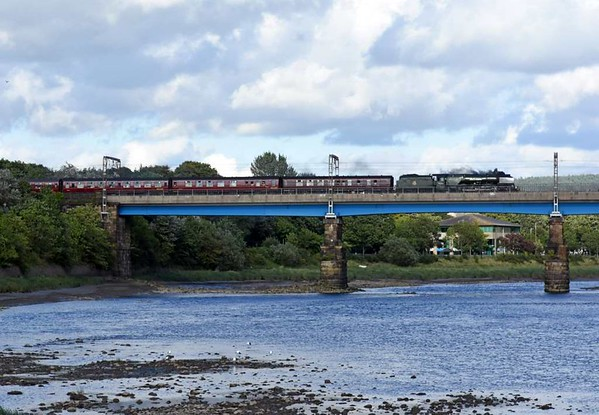 46233 Duchess of Sutherland, 1Z56, Lancaster, Sat 5 August 2017 - 1813.  The Duchess drifts across Carlisle bridge with the Railway Touring Co's 1552 Carlisle - Manchester Victora - Crewe Cumbrian Mountain Express.  The train had just left Carnforth after the usual water stop, but triggered a hotbox detector and stopped for examination on the Up Fast at Lancaster until 1840.  The 11 coaches were reported as 99041, 99304, 4973, 99328, 99311, 5239, 99125, 99127, 99316, recently restored Pullman 99025 Amber & Pullman 95402 (326) Emerald.  The outward leg had run via Settle.