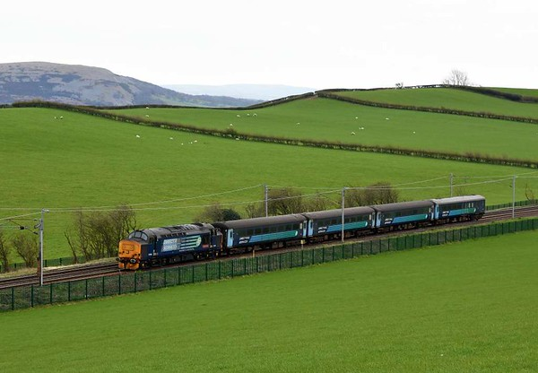 37409 Lord Hinton, 5Z38, Hincaster, Mon 3 April 2017 - 1341.  DRS's 1307 Preston - Kingmoor move with the stock off Northern's 2C32 0515 Carlisle - Preston.  The train had come to a stand at Garstang, reportedly because the fire bells had rung.  2C32 managed to reach Preston but its next working, 2C47 1004 to Barrow, was cancelled.