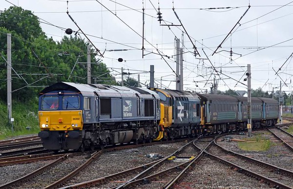 66302 & 37403 Isle of Mull, 5Z67, Carnforth, fri 23 June 2017 - 1155.  Another day, another failure...DRS's 1019 Barrow carriage sidings - Kingmoor move with 6008, 5995, 6117 & DBSO 9704. 37403 failed north of Maryport the following day on 2C41 0845 Barrow - Carlisle  and was taken to Kingmoor by 68022.