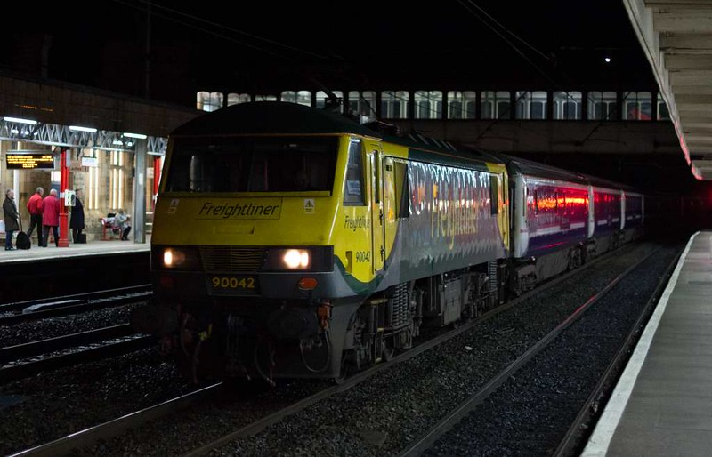90042, 1S26, Lancaster, Wed 4 January 2017 - 0634.   The 2350 Euston - Glasgow / Edinburgh Caledonian Sleeper, running 141 minutes late.  It had been delayed at Acton Grange where 66536 had to be rescued by 66559 after it failed while working Freightliner's 6M02 2033 Avonmouth - Fiddlers Ferry power station coal. Most unusually there had been a loco change en route, when 90042 replaced 90016 at Crewe.