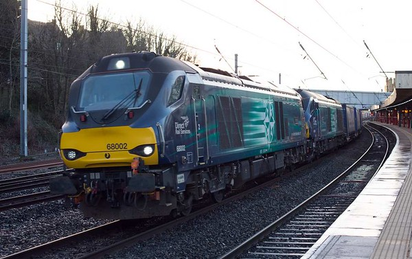 68002 Intrepid & 68024 Centaur, 4S43, Lancaster, Wed 4 January 2017 - 0920.  DRS's 0616 Daventry - Mossend Tesco Express. Defective 68002 was replaced at Kingmoor by 68022 off 6C18.