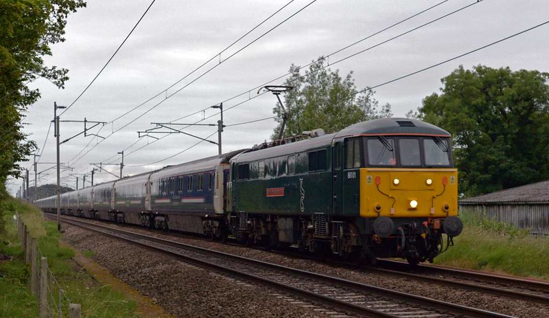 86101 Sir William A Stanier FRS, 1S26, Carnforth, Sat 1 July 2017 - 0507.  The 86 makes a very rare appearance on the 2350 Euston - Edinburgh  /  Glasgow Caledonian Sleeper, 48 minutes late.  It had left Euston 90 late at 0120 because of a threatened suicide at Rugby which closed the WCML 2015 - 0015.  1S26 reached Glasgow 26 late at 0744.  1B26 (90049) from Carstairs reached Edinburgh 27 late at 0748. 1S25 (92018) had left Euston 205 late at 0041, passed Carnforth 167 late at 0412 and was still 167 late when it reached Inverness (67030) at 1125.  1A25 (73968) reached Aberdeen 146 late at 1005.  1Y11 (73966) reached Fort William 231 late at 1346.  Virgin trains were also heavily delayed.  1S06 1930 Euston - Glasgow was terminated at Carlisle after arriving 255 late at 0305.  (The soutbound Caledonian Sleepers 1M11 (92033) and 1M16 (90047) both arrived at Euston on time.)
