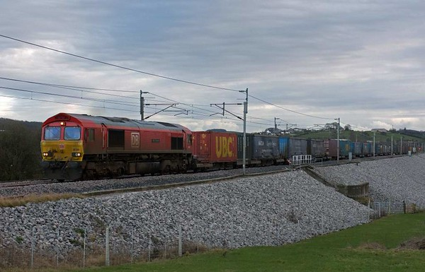 66055 Alain Thauvette, 4S49, Carnforth, Sat 14 January 2017 - 1537.  DB Cargo's large logo loco leads the 1112 Daventry - Grangemouth.  M Thauvette is the head of DB Cargo Regions West, which includes DB Cargo UK.