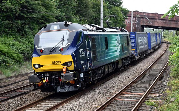 88003  Genesis, 4S43, Hest Bank, Mon 12 June 2017 - 0925.  DRS's new class makes its freight debut on the 0616 Daventry - Mossend Tesco. It later passed Holytown in diesel mode.  88002 was on standby at Daventry, and 88004 at Mossend; it subsequently worked 4M48.