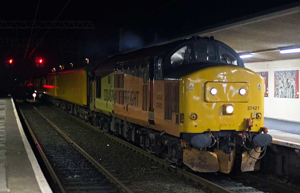 37421, 3Q32, Carnforth, Thurs 19 January 2017 - 2351.  Colas's 2244 Carlisle High Wapping - Neville Hill TRSMD sets off 49 minutes early. It had run via Shap.  The consist was structure gauging coaches 99666 & 72630, ultrasonic test coach 999605, generator van 6263 & DBSO 9702.