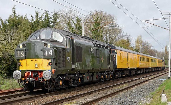 37421 & 37057, 1Q47, Carnforth, Tues 11 April 2017 - 1534.  Colas's 1052 Derby - Carlisle High Wapping test train heads north for a week in Scotland.  It ran via Shap not the coast as booked, probably because of the disruption caused by the failure of 2C34 1435 Carlisle - Barrow (37402) at Workington at 1540.  The consist was radio survey coach 977868, plain line pattern recognition coach 5981, overhead line inspection coach 977983 and generator van 6263.