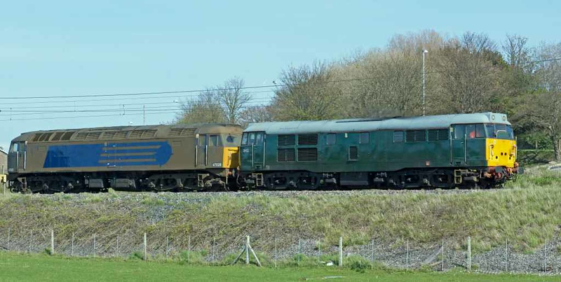 31452 & 47828, 0Z47, Carnforth, Wed 4 May 2016 - 1531.  A Carlisle - Exeter move as the Devon & Cornwall 31 takes former DRS 47 to a new life on the Dartmoor Railway.  The 47 is still coated in last year's Sandite grime after its railhead treatment train duties.