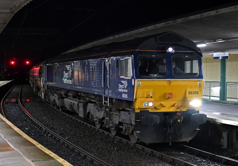 66305 & 66301 Kingmoor TMD, 6C61, Carnforth, Sat 12 January 2019 1 - 2018.  DRS's 1822 Basford Hall - Millom engineering train.  It comprised HQA autoballasters, KRA sleeper carriers carrying steel sleepers, and a Balfour Beatty Harsco New Track Construction Machine.