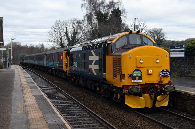 37409 Lord Hinton, 2C37, Silverdale, Fri 11 January 2019 - 1253.  The Arriva Northern / DRS Cumbrian Cosst Class 37 Farewell was run to mark the end of loco-hauled trains on the Cumbrian coast.  It had left Carlisle at 0952 and ran to Carnforth and back via Barrow both ways.  The consist was DBSO 9710, 5995, 6117 & 6046 with 37425 on the rear.