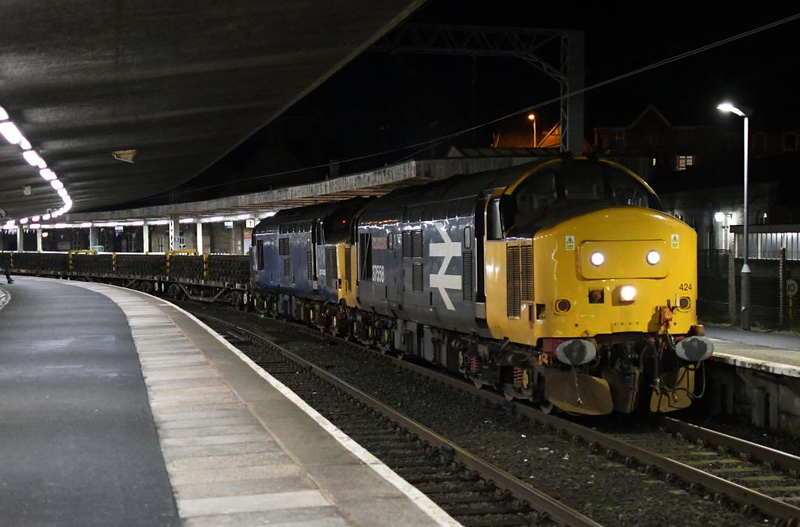 37424 Avro Vulcan XH558 & 37422, 6C57, Carnforth, Sun 13 January 2019 1 - 1910.  DRS's 1735 Millom - Basford Hall engineering train, mainly formed of YKAs loaded with track panels.
