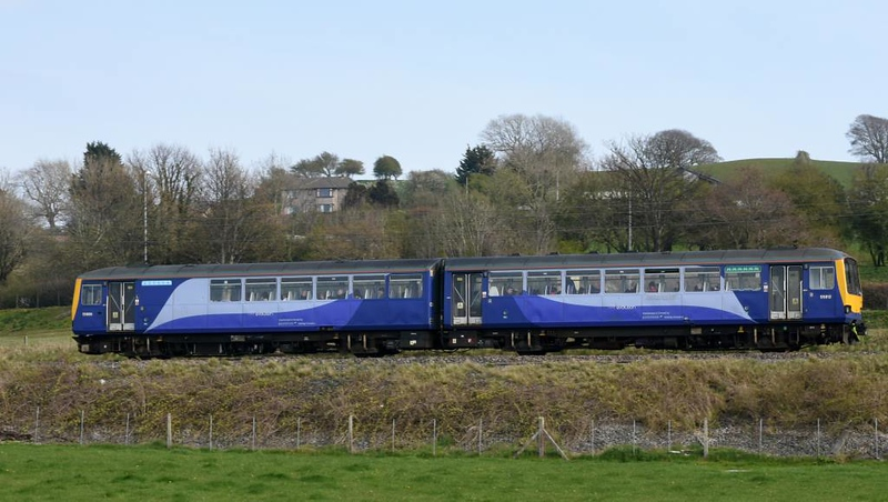 144012, 2Y01, Carnforth, Mon 15 April 2019 - 1530.  Northern's 1503 Morecambe - Leeds, worked by Porterbrook's class 144e Evolution Pacer, modified to comply with the Persons of Restricted Moblity accessibility regulations which come into force on 1 January 2020. Unmodified Pacers do not comply with these regulations and are expected to be withdrawn by the end of 2019 as a result, This demonstrator has new seats, trim and wi-fi as well as a bult-in ramp and toilet for wheelchair users.  The cost of modifying a two-car Pacer is estimated at £350,000; there have been no takers.