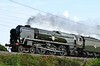 35018 British India Line, 5T53, Carnforth, Tues 11 August 2020 - 0959.   The Merchant Navy sets off for Preston to take over the Dalesman from Chester.  It should have gone to Hellifield, but had been diverted becaue of flooding.  The support coach was 80217.