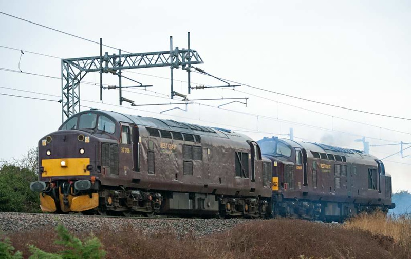 37706 & 37669, 0Z30, Carnforth, Wed 13 January 2021 - 0922.  WCRC's 0730 but 0850 Steamtown - Wigan LIP move to pick up withdrawn Cowans Sheldon breakdown crane DR 96710 and take it to Burton Wetmore.