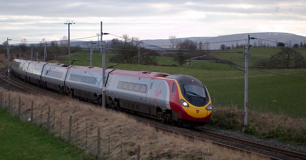 390053 Mission Accomplished, Penrith, 17 March 2008 - 1719   A few snow patches linger on the eastern fells as the 1346 Euston - Glasgow sweeps north.