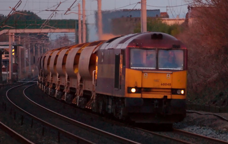 60048 Eastern, 6K05, 11 January 2008 - 1555   The 60 just catches the last rays of the setting sun as it heads south with EWS's 1314 Carlisle - Crewe departmental.