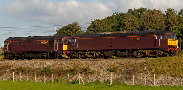 33025 Glen Falloch & 47760, 0Z47, Carnforth, 24 September 2008 - 1644    33025 brings the 47 home to Carnforth from Ely, where it had suffered a seized axle on 6 July.  One of its bogies was changed on 20 September at Ely, permitting it to return to Carnforth by rail.
