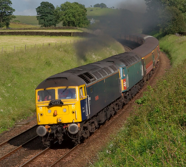 47839 Pegasus & 47853 Rail Express, 1Z94, Long Preston, 5 July 2008 - 1728 1    After reversing at Hellifield, Compass's Cumbrian Fellsman retraces its steps as far as Settle Junction where it will take the little North Western line to Carnforth and the WCML.  As the clag shows, 47853 was dead between Hellifield and Preston.