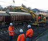 Removing spent ballast, Carnforth, 5 April 2008 - 1838   Engineers discuss next steps as a tracked roadrailer removes spent ballast from the place where two wheeled roadrailers were seen removing a track panel earlier.