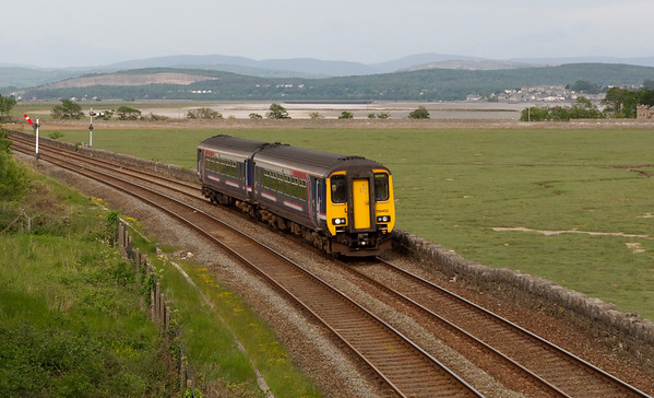 156452, Grange-over-Sands, 26 May 2008 - 1754    Northern's 1557 Liverpool - Barrow approaches Grange.  Arnside Viaduct can be seen in the distance above the front coach of the DMU, and Arnside is in the right distance.