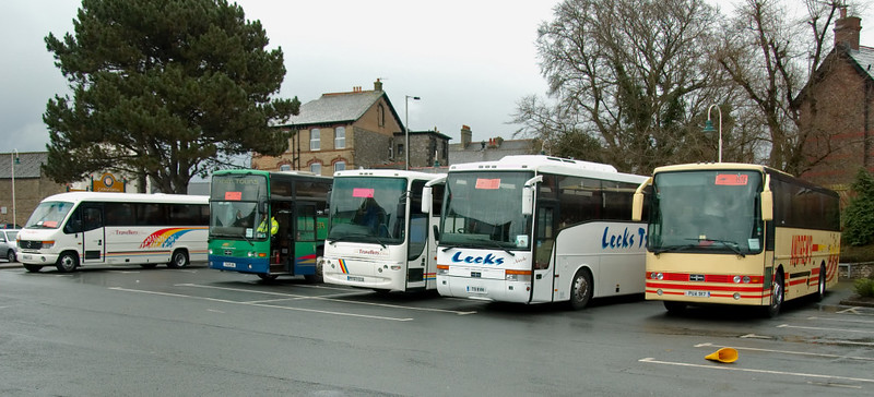 Rail replacement buses, Carnforth, 29 March 2008 - 1610 1    Buses replaced Northern's Leeds - Morecambe services between Bentham and Morecambe via Carnforth.  Buses also replaced Northern's Cumbrian coast services, and FTPE's Barrow services, between Carnforth and Lancaster.  Virgin and FTPE services between Preston, Lancaster, Oxenholme / Windermere and Carlisle were mainly replaced by buses not calling at Carnforth, though a few Virgin trains were diverted onto the Settle & Carlsile.  The four buses at right are 7529 UK (green), PF57 CCU, T9 RVN and PUA 917.