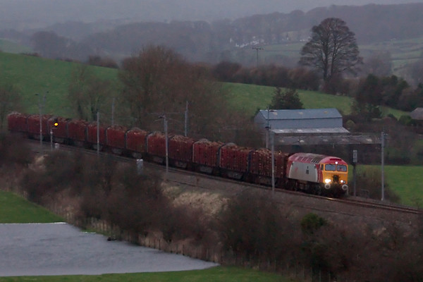 57314 Firefly, 6J37, Milnthorpe, 25 January 2008 - 1612   Colas's Carlisle - Chirk timber at dusk.