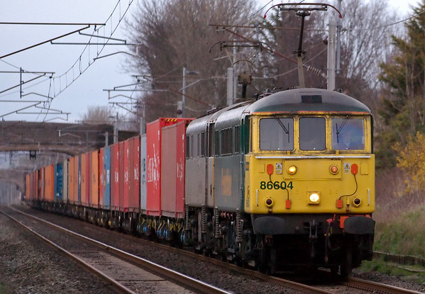 86604 & 86637, 4M74, Carnforth, 25 March 2008 - 1740    The afternoon Coatbridge - Crewe Liner.  NB the locos have different types of pantograph.