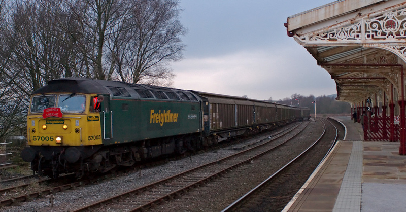 57005. Hellifield, 8 February 2008 6 - 1646   The 57 propels the cut past the station.