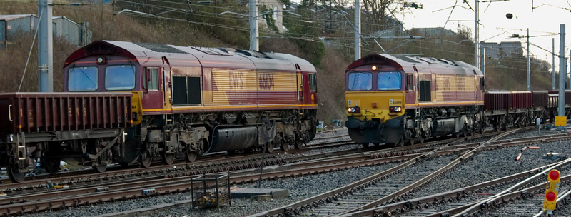 66104 & 66048, Carnforth, 5 April 2008 - 1827    66104 (left) propels its train of empty spoil wagons past 66048