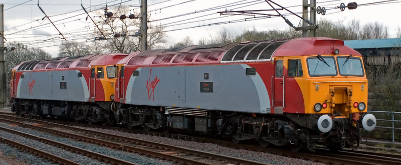 57311 Parker & 57309 Brains, Preston, 28 March 2008 - 1729 1  57309 removes failed 57311 from the 6J37 Carlisle - Chirk timber train.