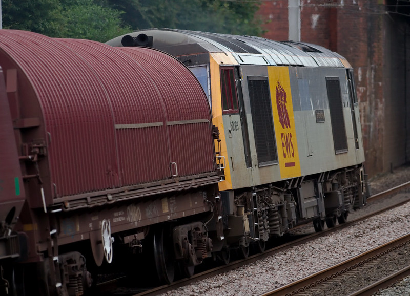 60063 James Murray, 4M08, Hest Bank, 22 July 2008 - 1637    A snatched shot of this unexpected 60 on the 1428 Carlisle - Warrington coal.  The train was formed of HTAs, with this steel carrier presumably acting as a barrier wagon for coupling purposes.