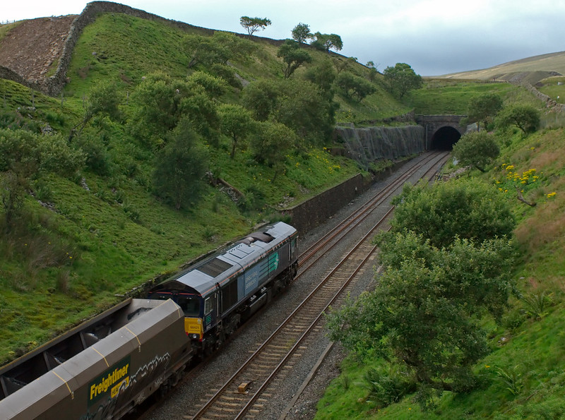 66421, 4S68, Blea Moor Tunnel, 6 August 2008 - 1831    On hire to Freightliner, the DRS loco heads north with the FX-Q 1407 Drax Power Station - Killoch mgr empties.  NB that remedial drainage work is under way on the crest at left.