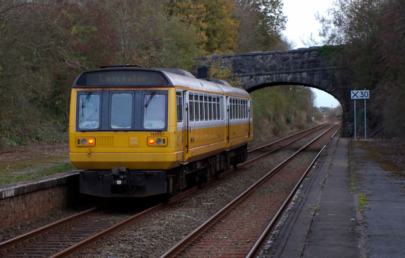 142057, Silverdale, 30 October 2008 4 - 1622    Having picked up a number of walkers, the Pacer sets off for Lancaster past the disused end of Silverdale's lengthy platforms, originally provided for excursion traffic.
