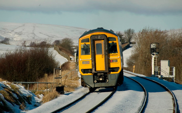158909, Horton in Ribblesdale, 6 December 2008 - 1157    Northern's 1049 Leeds - Carlisle, formed of 158902 & 158909, passes the new up IBS signal.  The new down signal can also be seen in the distance.