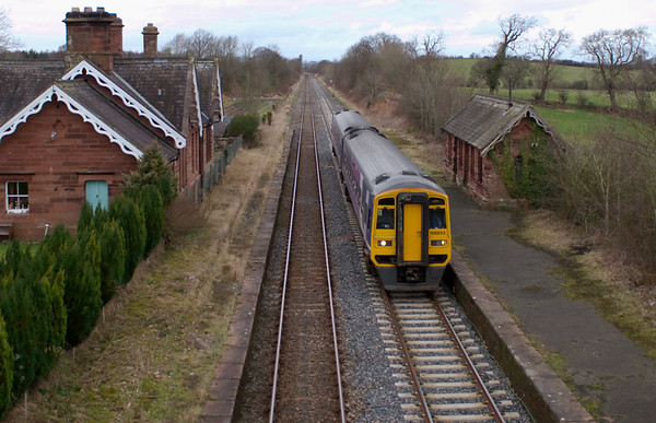 185853, Cumwhinton, 23 February 2008 - 1437    Northern's 1426 Carlisle - Leeds passes the former Cumwhinton Station, closed as early as 1956.  NB that the up line on which the 158 is travelling has been relaid with welded rail on concrete sleepers (to cope with loaded freight trains), but the down line (which mainly carries empties) still has jointed track on wooden sleepers.