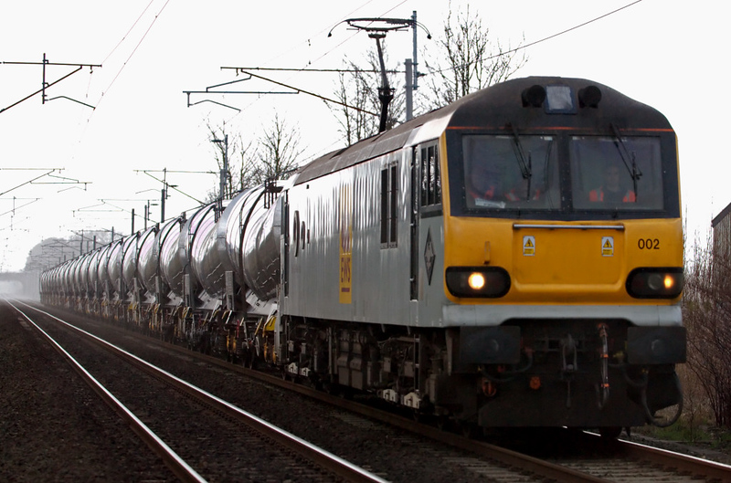 92002 H G Wells. 6S94, Carnforth, 9 January 2008 - 1052 1   This was the first working of EWS's (Antwerp - ) Wembley - Mossend ( - Irvine) china clay train, which has replaced the long-running Burngullow - Irvine services.  The train was formed of 20 refurbished ICA 'Silver Bullets'.