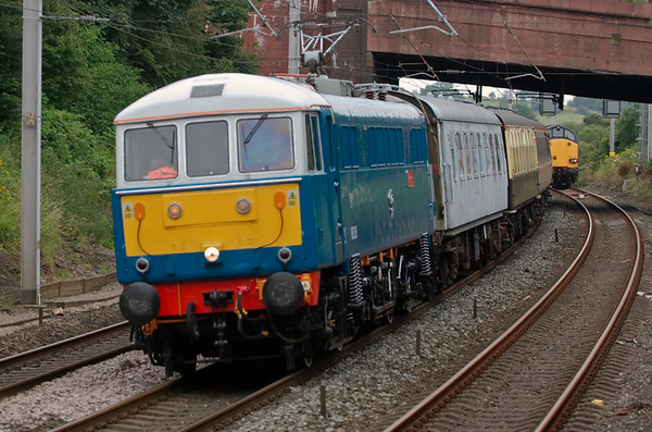 86259 Les Ross, 5Z86, Hest Bank, 22 July 2008 - 1613     The preserved 86 moves empty stock from Tyseley to Carnforth, passing DRS 37606 (& 37611) held on the Bare Lane branch with the 1535 Heysham - Sellafield flasks.  Behind the 86 is a 1960s Metro-Cammell Pullman caked in graffiti, so presumably going to Steamtown for a repaint.