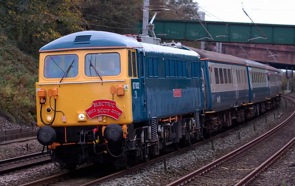 87002 Royal Sovereign, 1Z87, Hest Bank, 15 October 2008 - 1045 1     The gleaming veteran slows past Hest Bank as it had caught up with Northern's 1010 Preston - Carlisle.  It was working Spitfire's 'Electric Scot Tribute' from Birmingham International to Glasgow, formed of 12 blue and gray Cargo D Mk 2s and 3s.